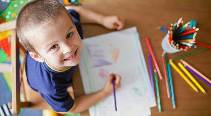 boy smiling drawing